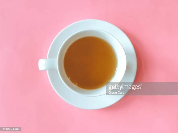 cup of tea with saucer on pink background - saucer stock pictures, royalty-free photos & images