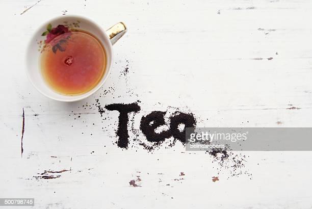 Cup of tea with word tea spelled in tea leaves