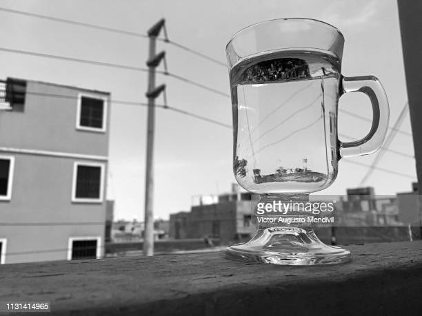 cup of water - blanco y negro stock pictures, royalty-free photos & images