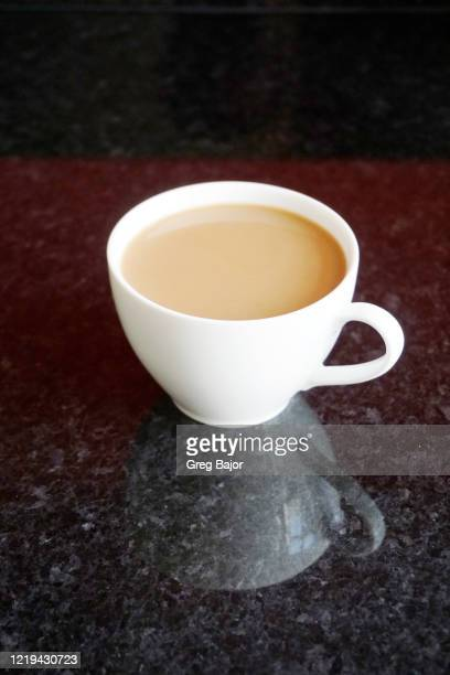 cup of white coffee - greg bajor stock pictures, royalty-free photos & images
