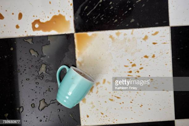cup on floor surrounded by spilt coffee, overhead view - spilling stock pictures, royalty-free photos & images