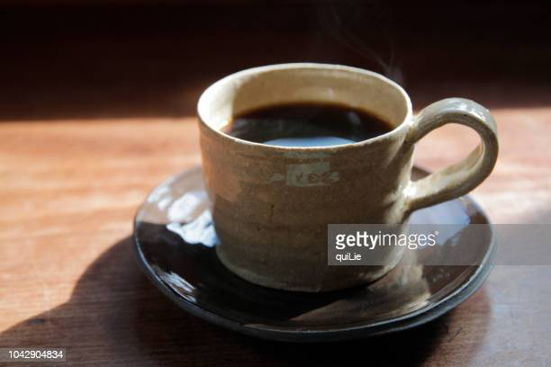 a cup pf coffee in pottery - saucer stock pictures, royalty-free photos & images