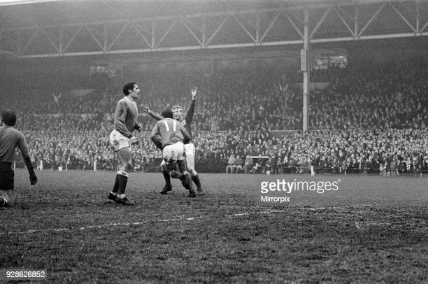 FA Cup Quarter Final match at the City Ground Nottingham Forest 3 v Everton 2 Forest winger Ian Storey Moore congratulated by teammate Alan Hinton...