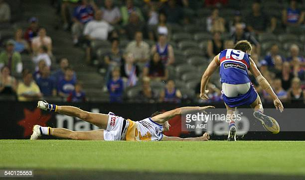 2007 NAB Cup Round 2 Western Bulldogs V Brisbane at the Telstra Dome Brisbane's Will Hamill grabs the pants off Bulldog's Shaun Higgins 2nd March...