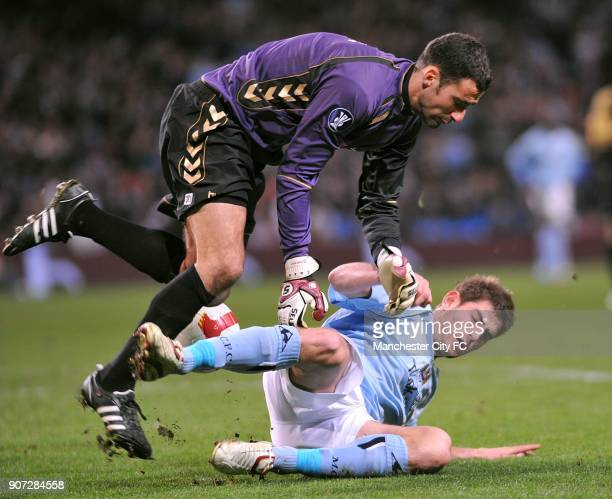 Cup Round of 16 First Leg Manchester City v AaB Aalborg City of Manchester Stadium AaB Aalborg's goalkeeper Karim Zaza and Manchester City's Ched...