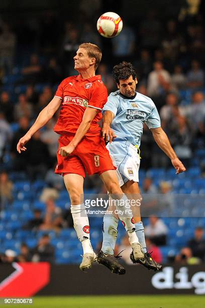 Cup Second Qualifying Round First Leg Manchester City v Midtjylland City of Manchester Stadium Manchester City's Tal Ben Haim wins the ball from FC...