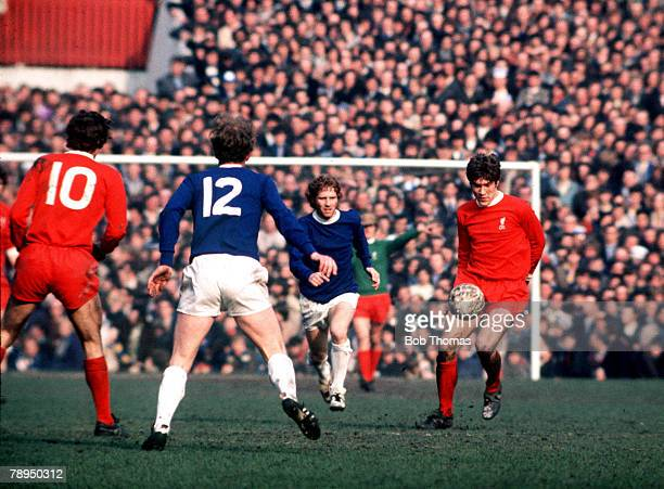FA Cup SemiFinal Old Trafford Manchester England 27th March Liverpool 2 v Everton 1 Emlyn Hughes of Liverpool brings the ball away from Everton's...