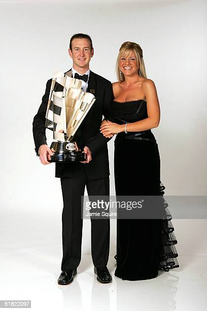 Cup Series Champion Kurt Busch and his girlfriend Eva Bryan pose with the NASCAR NEXTEL Cup trophy prior the 2004 NASCAR Nextel Cup Awards at the...