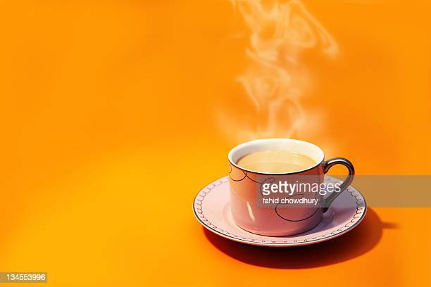 cup tea smoke yellow orange - chai stock photos and pictures