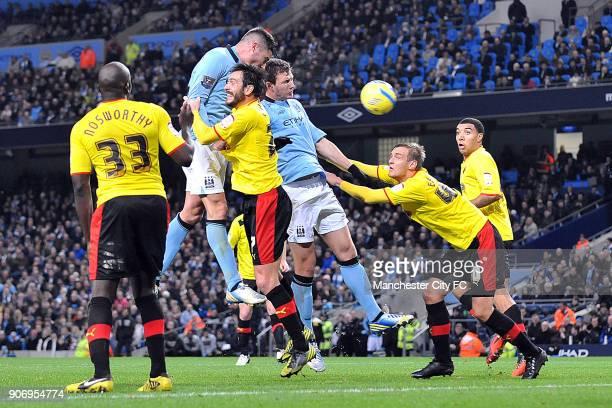 Cup, Third Round, Manchester City v Watford, Etihad Stadium, Manchester City's Edin Dzeko heads the ball over the head of Watford's Joel Ekstrand