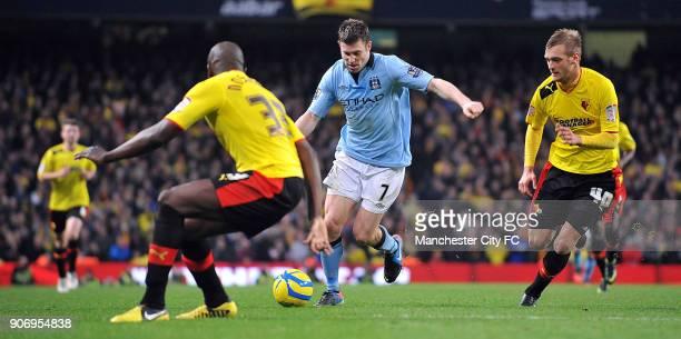 Cup, Third Round, Manchester City v Watford, Etihad Stadium, Manchester City's James Milner runs the ball through Watford's Joel Ekstrand and Nyron...