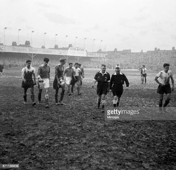 Cup Third Round match at Kenilworth Road. Luton Town 0 v Leicester City 4. Players trudge off the mud covered pitch, 11th January 1956.