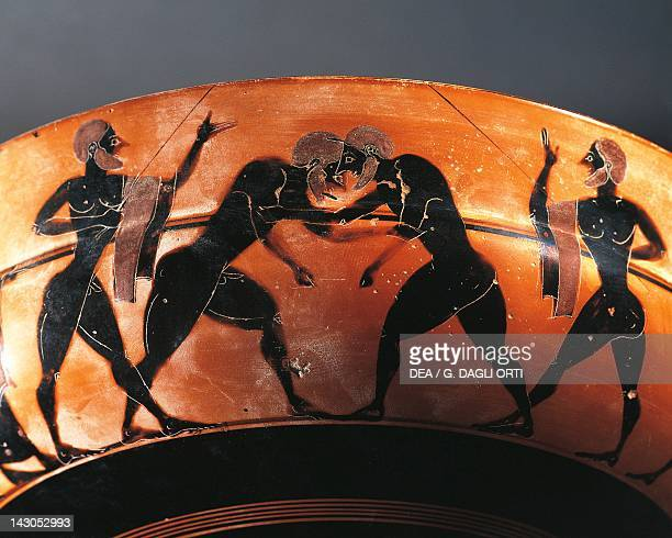 Cup with a scene of the gymnasium with two referees and two wrestlers blackfigure pottery Italy Detail Ancient Greek civilization Magna Graecia Bari...