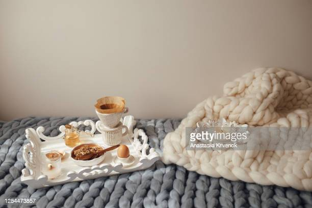 cup with filter coffee, organic granola with honey on grey and beige wool merino giant plaid. comfortable at home, happy mood and leisure cozy morning concept. - hygge stock-fotos und bilder