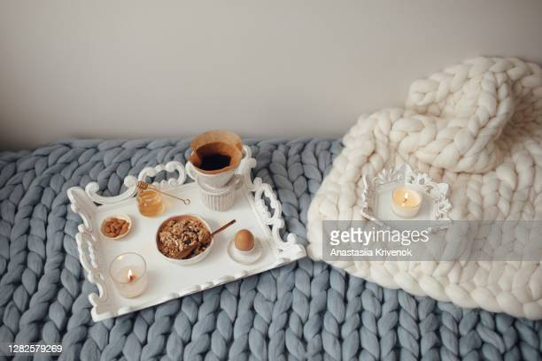 cup with filter coffee, organic granola with honey on grey and beige wool merino giant plaid. comfortable at home, happy mood and leisure cozy morning concept. - tricoté photos et images de collection