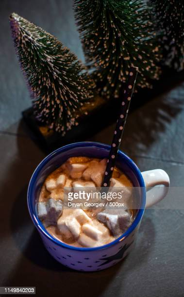 cup with milk and marshmallow for christmas - theobroma stock photos and pictures