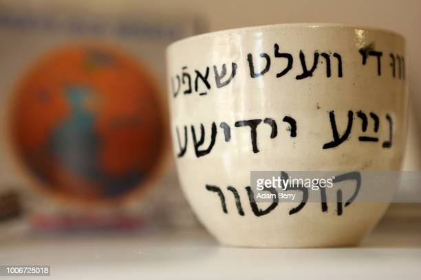 Cup with Yiddish written on it is seen during Yiddish Summer Weimar on July 27, 2018 in Weimar, Germany. The annual five-week summer institute and...