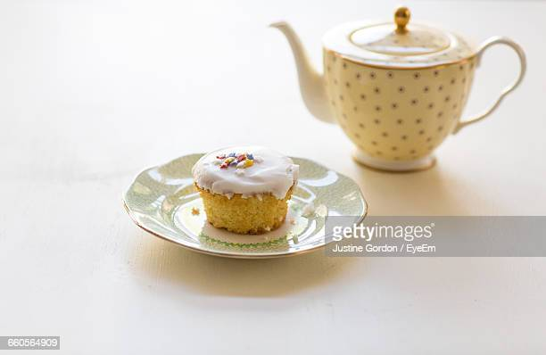 Cupcake By Teapot On Table
