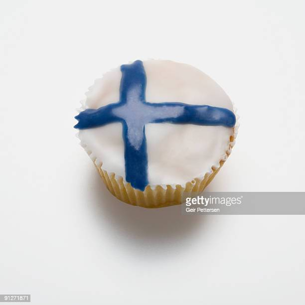 cupcake decorated with the flag of finland - finnish flag stock photos and pictures