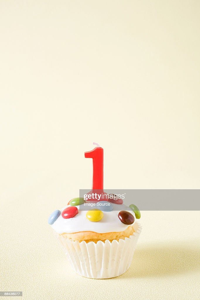 Cupcake With Number One Candle Stock Photo Getty Images
