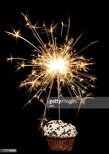 cupcake with sparkler on black - sparkler stock pictures, royalty-free photos & images