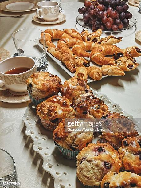 Cupcakes And Croissants With Coffee On Table