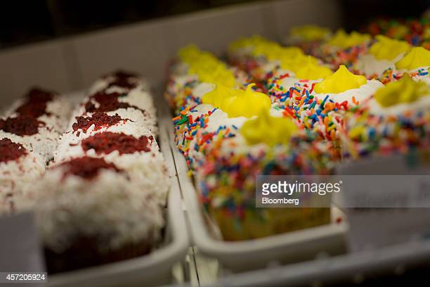 Cupcakes are displayed for sale during the reopening of a Crumbs Bake Shop Inc store in New York US on Tuesday Oct 14 2014 Crumbs Bake Shop the...