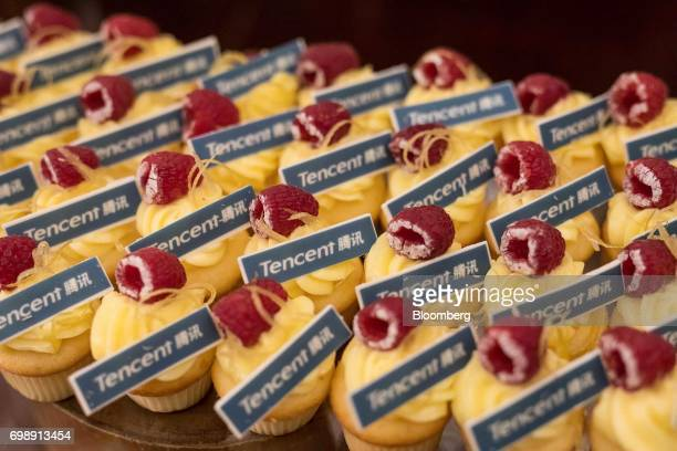 Cupcakes bearing the Tencent Holdings Ltd logo sit on a table at the GuangdongHong KongMacao Greater Bay Area Forum in Hong Kong China on Tuesday...