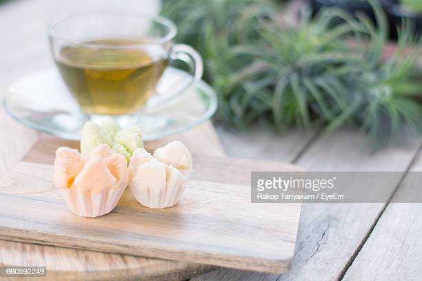 Cupcakes On Cutting Board With Tea Cup