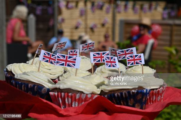 Cupcakes with Union flags attached are on a plate at a residents tea party to mark the 75th anniversary of VE Day the end of the Second World War in...