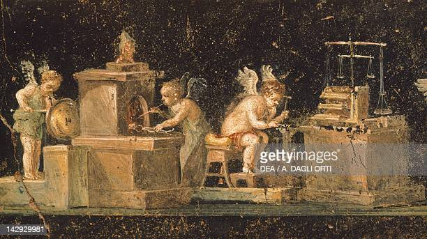 Cupids, goldsmiths and blacksmiths, a fresco from the House of the Vettii, Pompeii , Campania. Roman Civilization, 1st Century.