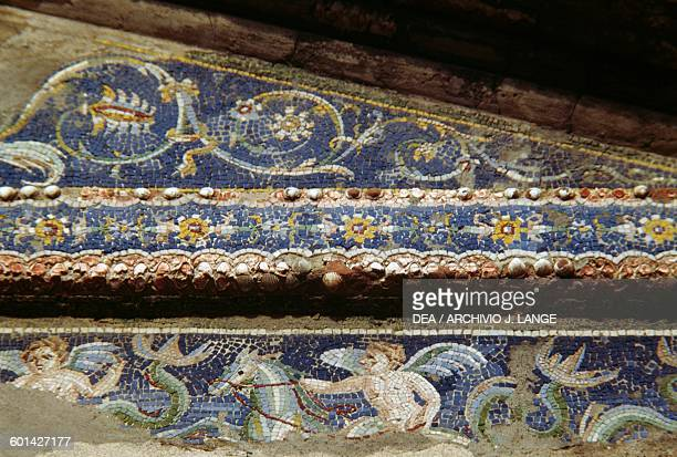 Cupids riding sea creatures detail from the mosaic on the pediment of the triclinium House of the Deer Herculaneum Campania Italy Roman civilisation...