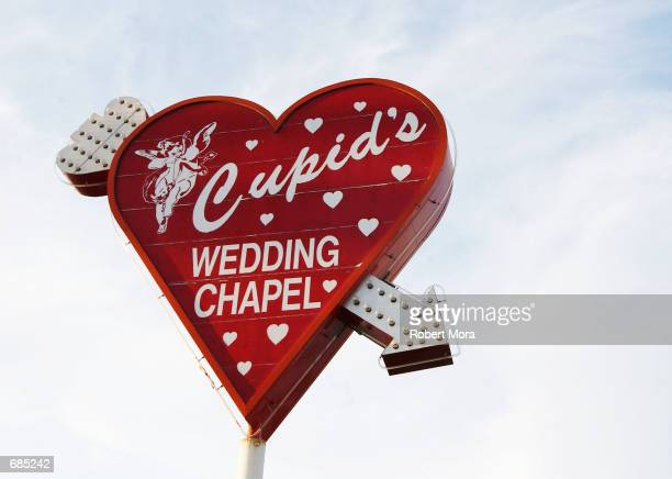 Cupid's Wedding Chapel sign is seen on display on May 30 2002 in Las Vegas Nevada