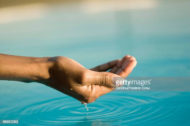 Cupped hand holding water