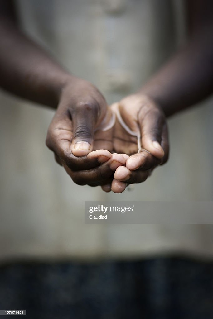 Cupped hands of girl with water : Stock Photo