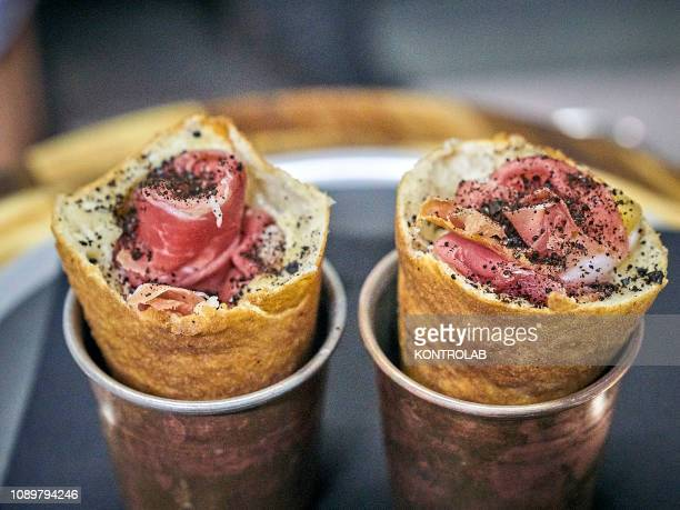 Cupper cup with a piece of Ananascosta served at pizzeria Pepe in Grani in Caiazzo near Caserta southern Italy Ananascosta is a new fried pizza with...