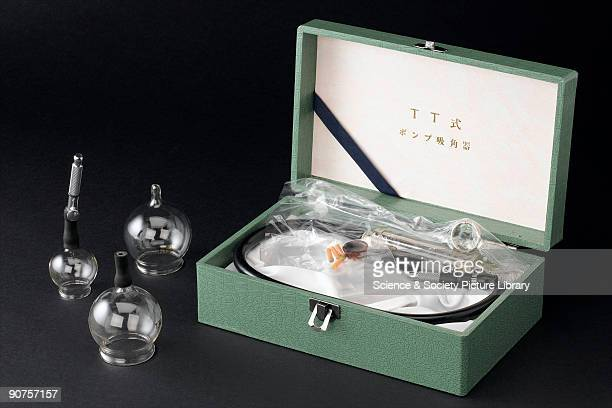 Cupping kit consisting of a box containing three graded cupping glasses for Dry Cupping Vacuum Therapy from the surgery of a British practitioner c...