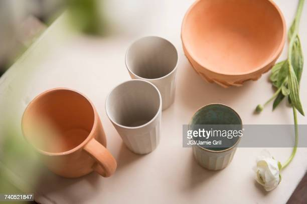 cups and bowl on table - ceramic stock pictures, royalty-free photos & images