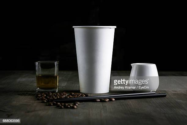 Cups And Coffee Beans On Table