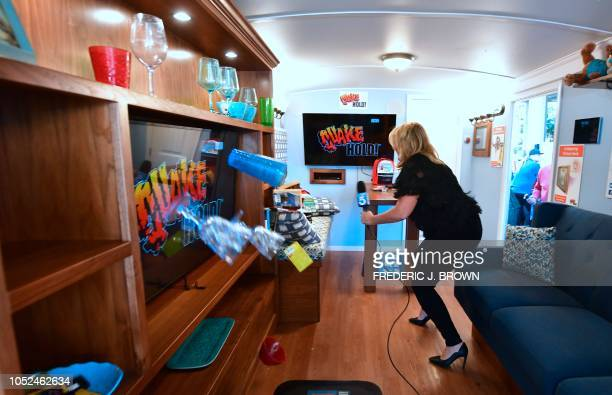 Cups and glasses fly off the shelf as a recreation of the Northridge 68 earthquake strikes for 17 seconds inside the Big Shaker an earthquake...