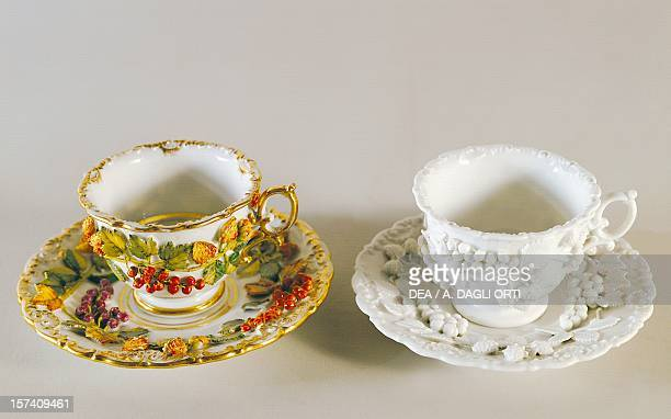 Cups and saucers with embossed decorations ceramic Jacob Petit manufacture, Fontainebleau. France, 19th century. Milan, Castello Sforzesco, Civiche...