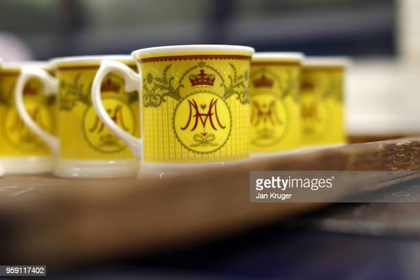 Cups are prepared as part of a special collection ahead of the wedding of Prince Harry and Meghan Markle at William Edwards Home Ltd on May 16 2018...