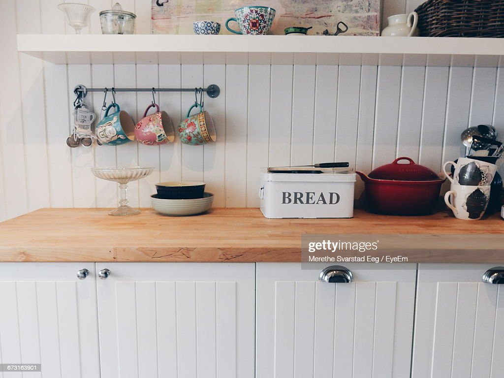 Cups Hanging By Containers On Kitchen Counter : Stock Photo