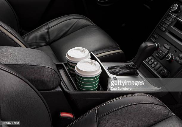 cups in a car holder - car interior stock pictures, royalty-free photos & images