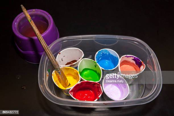 cups of bright paint colors - tempera painting stock pictures, royalty-free photos & images