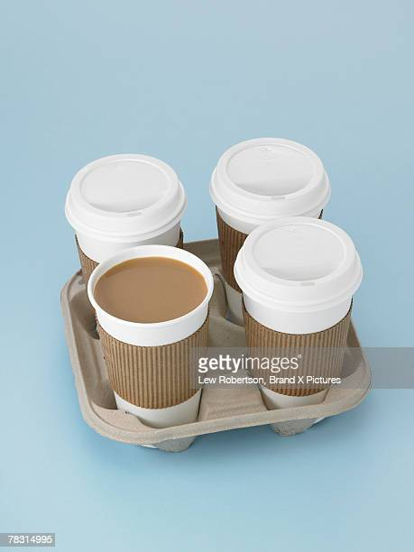 Cups of coffee in takeout tray