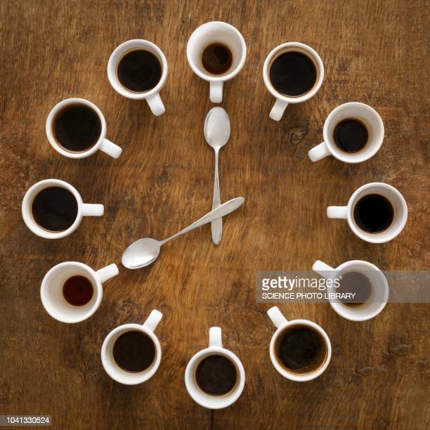 cups of coffee making the shape of a clock - coffee break stock pictures, royalty-free photos & images