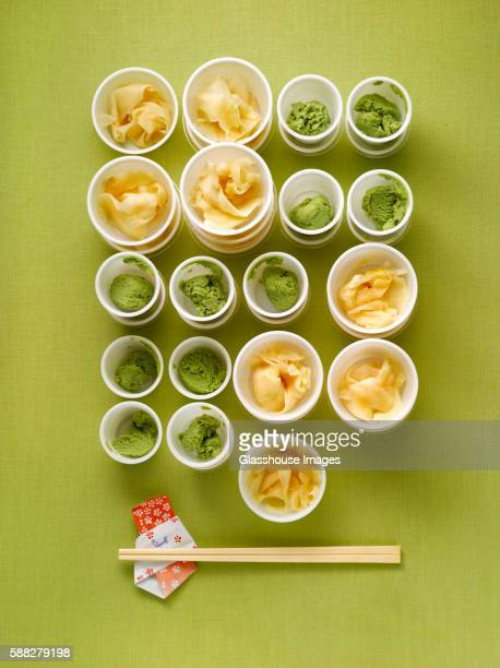 cups of ginger and wasabi with chopsticks - wasabi stock pictures, royalty-free photos & images
