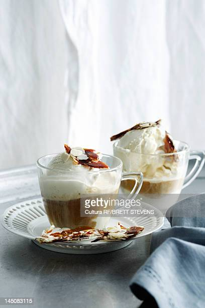 Cups of hot chocolate with nut brittle