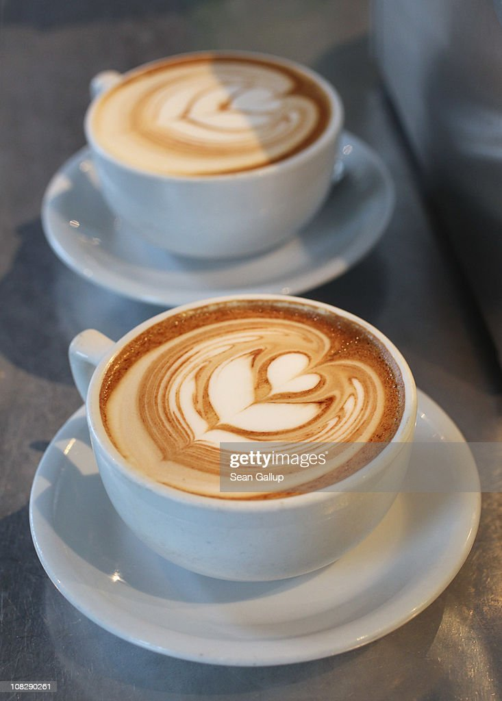 Cups of just-brewed flat white, a variation on the classic cappuccino, stand on a counter at Bonanza Coffee Roasters on January 24, 2011 in Berlin, Germany. Bonanza founder Kiduk Reus is among a growing number of so-called third wave artisinal coffee bean roasters who are finding a niche market in Europe and the USA for their carefully-crafted and expensive coffee. Reus insists that the cast iron parts, the slow-roasting abilities and hands-on controls of his flame-roasting, refurbished 1918 Probat machine allow him to develop the most flavour from his carefully selected beans.